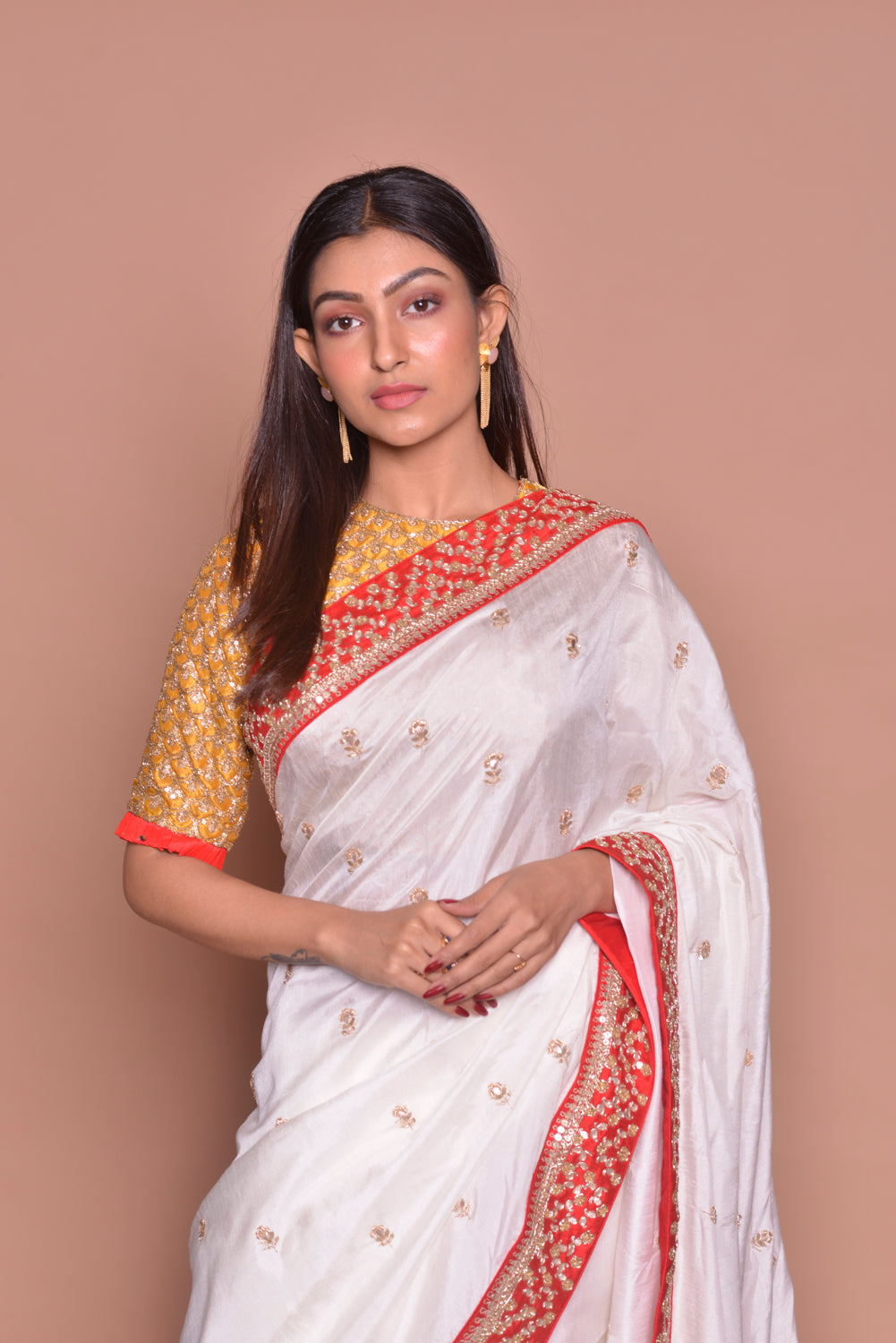 Shop stunning white embroidered muga silk saree online in USA with mustard embroidered saree blouse. Look fashionable on special occasions in contemporary sarees, designer sarees with blouse, embroidered saris from Pure Elegance Indian luxury clothing store in USA.-closeup