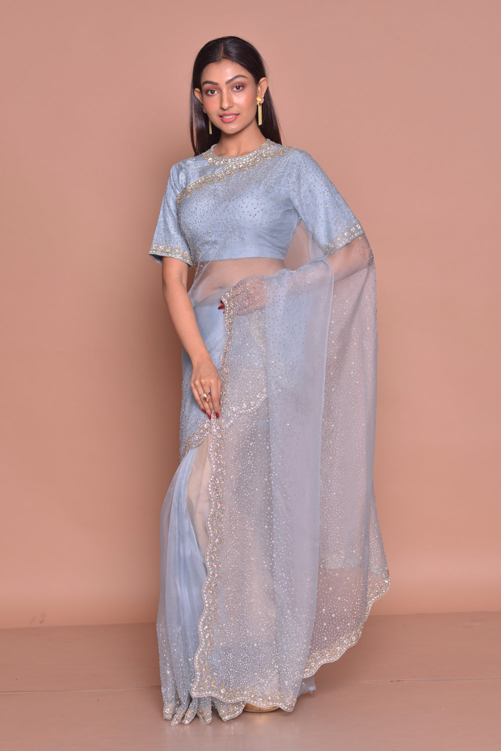 Buy chambray blue embroidered sari online in USA with saree blouse. Be occasion ready with exquisite range of designer sarees with blouse, bridal sarees from Pure Elegance Indian boutique in USA.-front