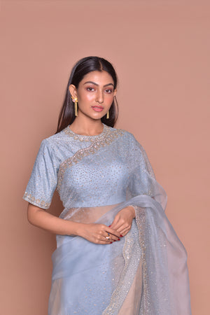 Buy chambray blue embroidered sari online in USA with saree blouse. Be occasion ready with exquisite range of designer sarees with blouse, bridal sarees from Pure Elegance Indian boutique in USA.-closeup