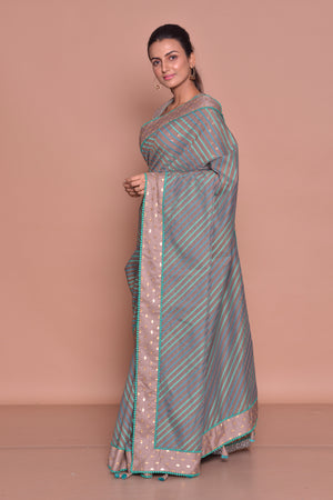 Shop brown sari online in USA with green stripes and saree blouse. Be occasion ready with exquisite range of designer sarees with blouse, bridal sarees from Pure Elegance Indian boutique in USA.-side