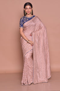 Buy gorgeous champagne pink embroidered sari online in USA with blue embroidered saree blouse. Look fashionable on special occasions in contemporary sarees, designer sarees with blouse, embroidered saris from Pure Elegance Indian luxury clothing store in USA.-full view
