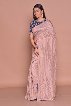 Buy gorgeous champagne pink embroidered sari online in USA with blue embroidered saree blouse. Look fashionable on special occasions in contemporary sarees, designer sarees with blouse, embroidered saris from Pure Elegance Indian luxury clothing store in USA.-side
