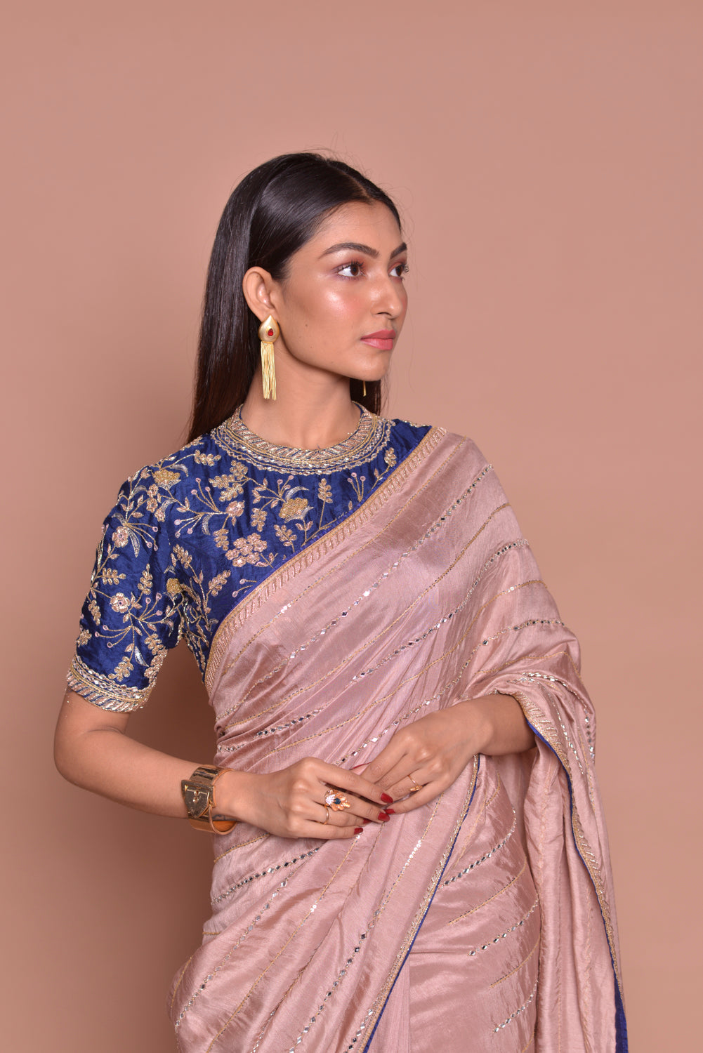 Buy gorgeous champagne pink embroidered sari online in USA with blue embroidered saree blouse. Look fashionable on special occasions in contemporary sarees, designer sarees with blouse, embroidered saris from Pure Elegance Indian luxury clothing store in USA.-closeup