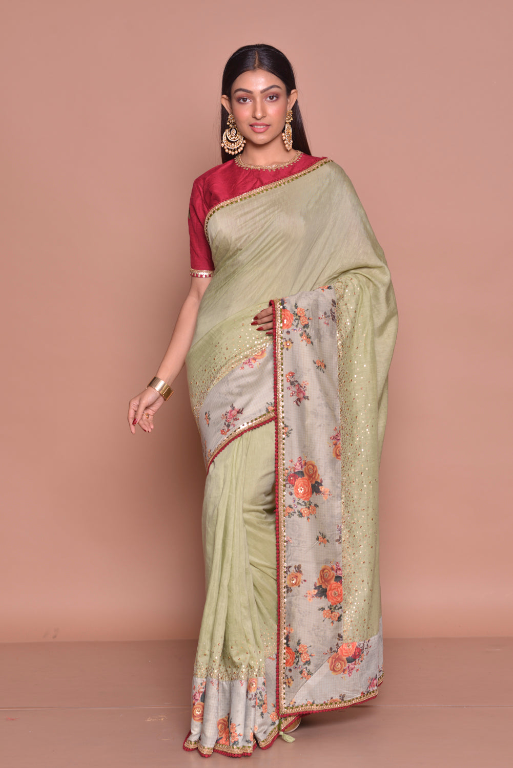 Buy exquisite pista green embroidered saree online in USA with floral border and red embroidered saree blouse. Be occasion ready with exquisite range of designer sarees with blouse, bridal sarees from Pure Elegance Indian boutique in USA.-front