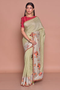 Buy exquisite pista green embroidered saree online in USA with floral border and red embroidered saree blouse. Be occasion ready with exquisite range of designer sarees with blouse, bridal sarees from Pure Elegance Indian boutique in USA.-full view