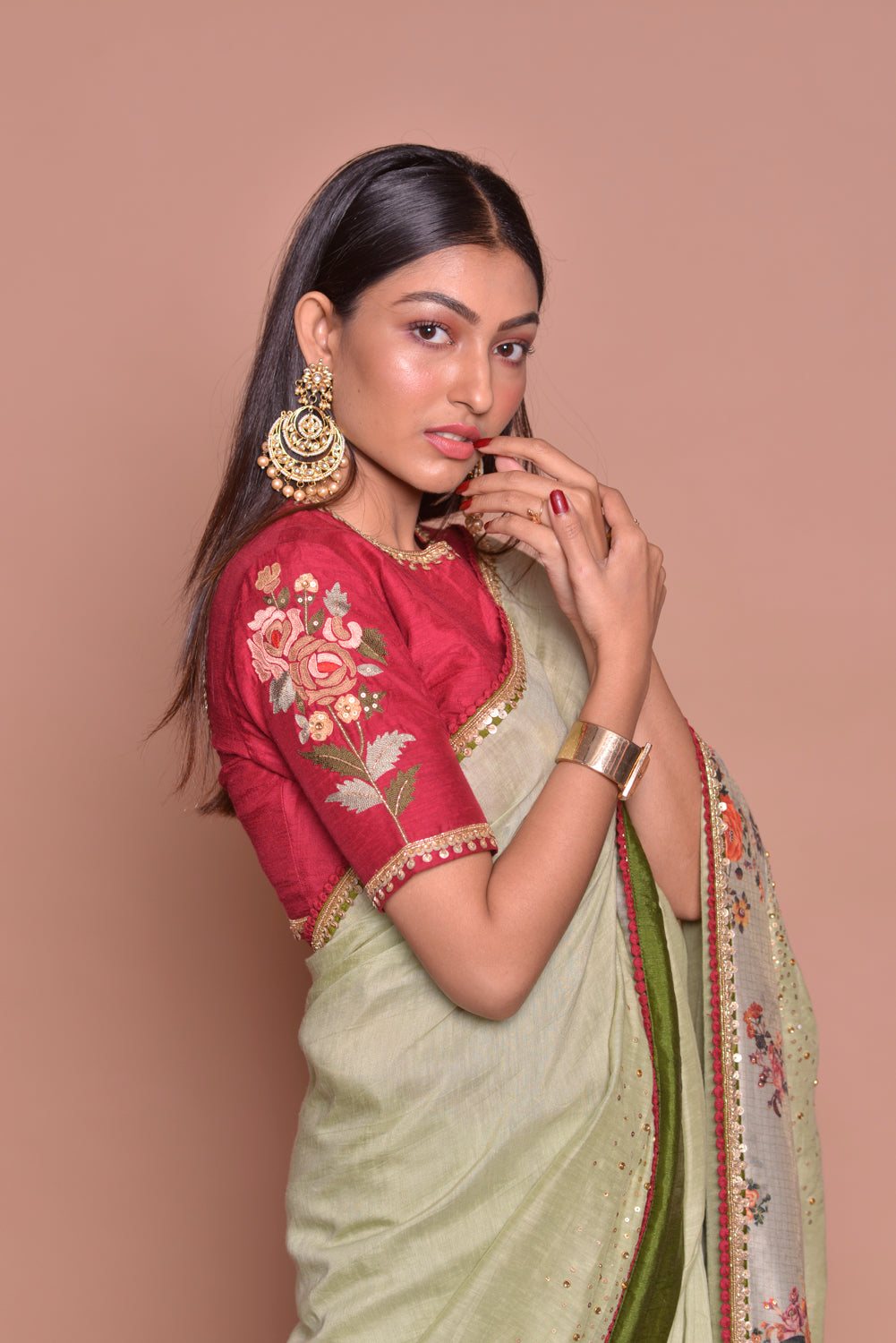 Buy exquisite pista green embroidered saree online in USA with floral border and red embroidered saree blouse. Be occasion ready with exquisite range of designer sarees with blouse, bridal sarees from Pure Elegance Indian boutique in USA.-closeup