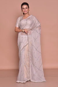Buy elegant light grey embroidered organza silk saree online in USA with saree blouse. Look fashionable on special occasions in contemporary sarees, designer sarees with blouse, embroidered saris from Pure Elegance Indian luxury clothing store in USA.-full view