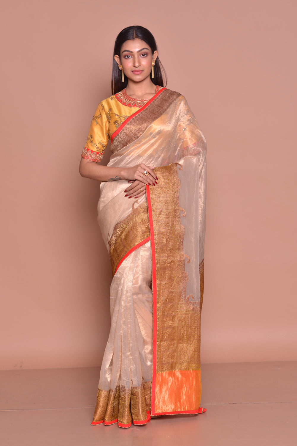 Shop gorgeous cream golden saree online in USA with zari border and yellow embroidered saree blouse. Be occasion ready with exquisite range of designer sarees with blouse, bridal sarees from Pure Elegance Indian boutique in USA.-full view