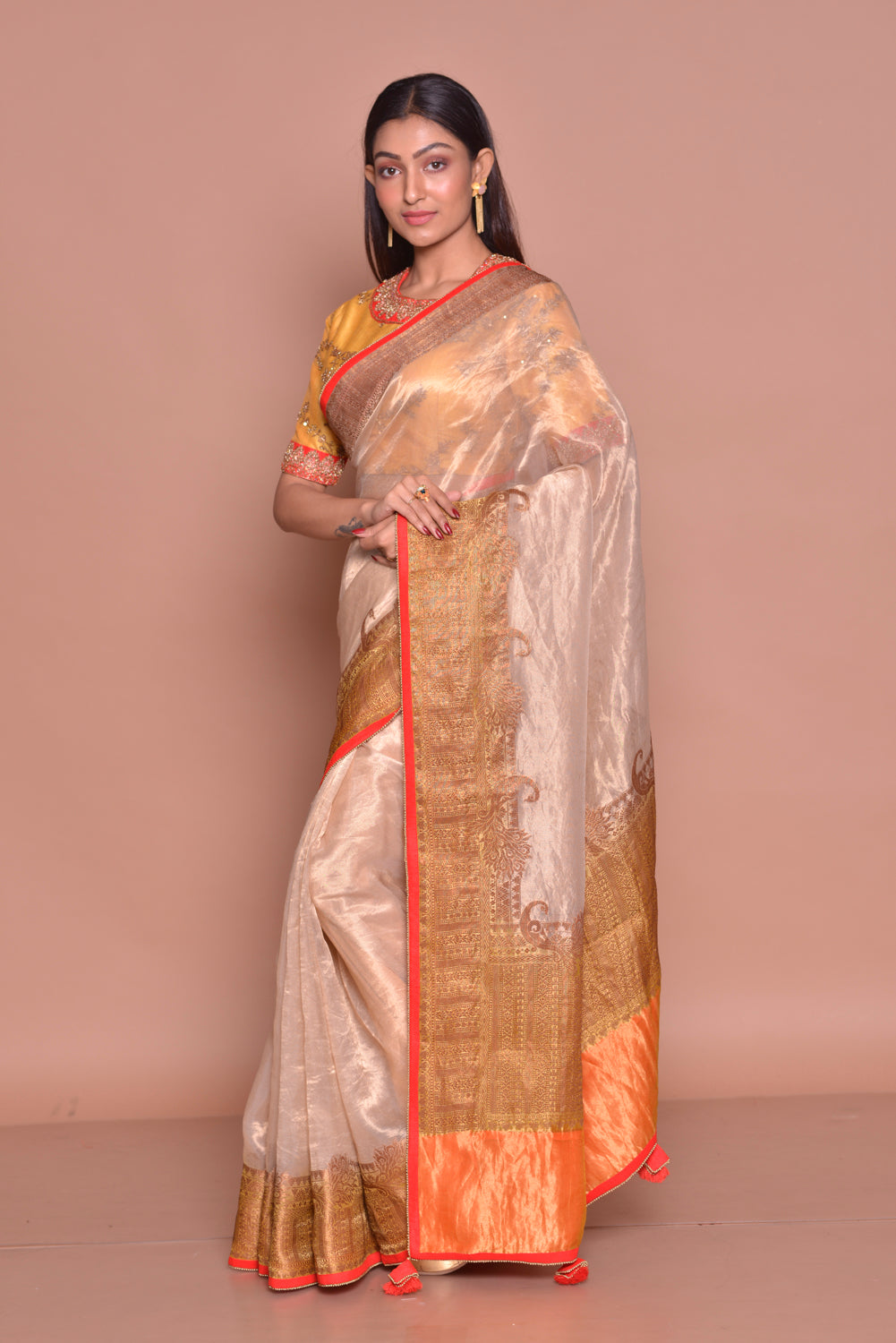 Shop gorgeous cream golden saree online in USA with zari border and yellow embroidered saree blouse. Be occasion ready with exquisite range of designer sarees with blouse, bridal sarees from Pure Elegance Indian boutique in USA.-side