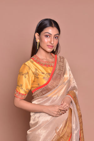 Shop gorgeous cream golden saree online in USA with zari border and yellow embroidered saree blouse. Be occasion ready with exquisite range of designer sarees with blouse, bridal sarees from Pure Elegance Indian boutique in USA.-closeup