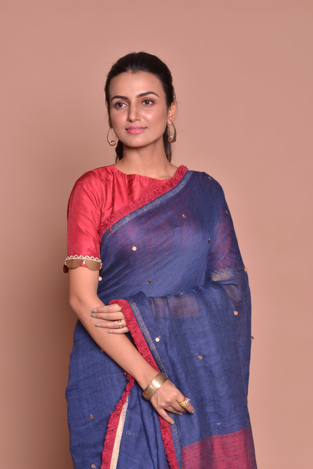 Shop navy blue saree online in USA with maroon frill lace and maroon blouse. Be occasion ready with exquisite range of designer sarees with blouse, bridal sarees from Pure Elegance Indian boutique in USA.-closeup