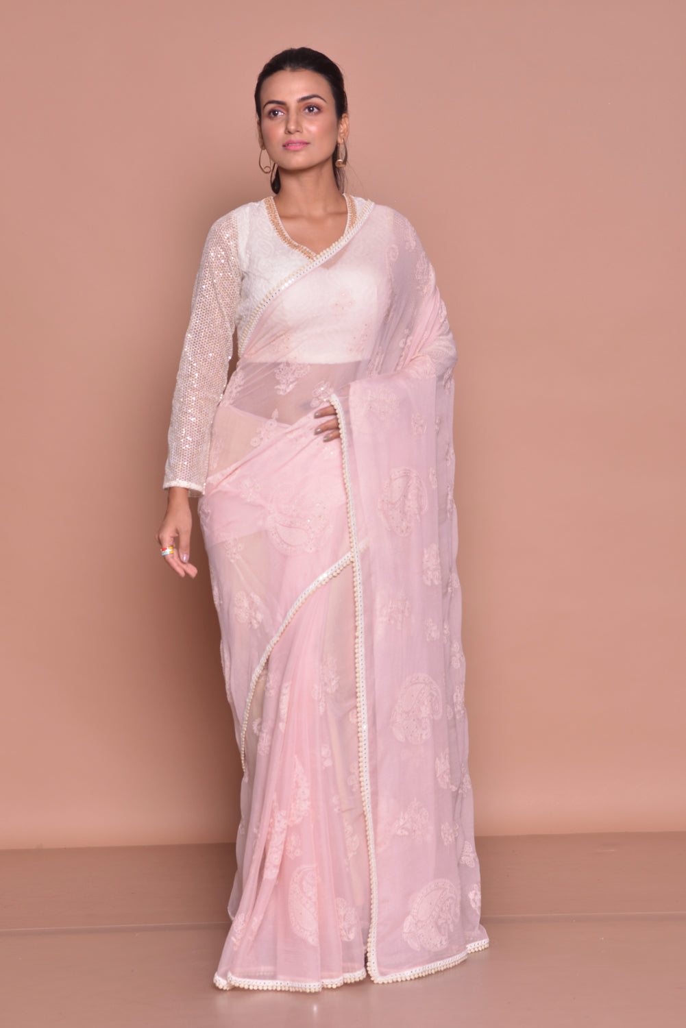 Buy beautiful powder pink embroidered saree online in USA with embroidered sari blouse. Be occasion ready with exquisite range of designer sarees with blouse, bridal sarees from Pure Elegance Indian boutique in USA.-full view