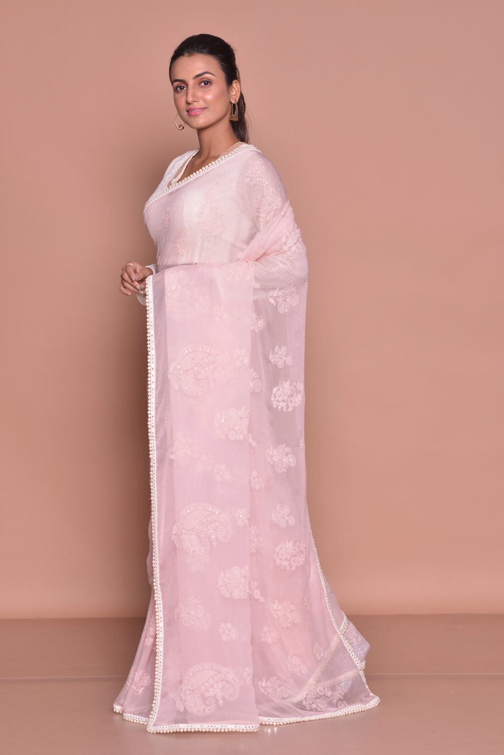 Buy beautiful powder pink embroidered saree online in USA with embroidered sari blouse. Be occasion ready with exquisite range of designer sarees with blouse, bridal sarees from Pure Elegance Indian boutique in USA.-side