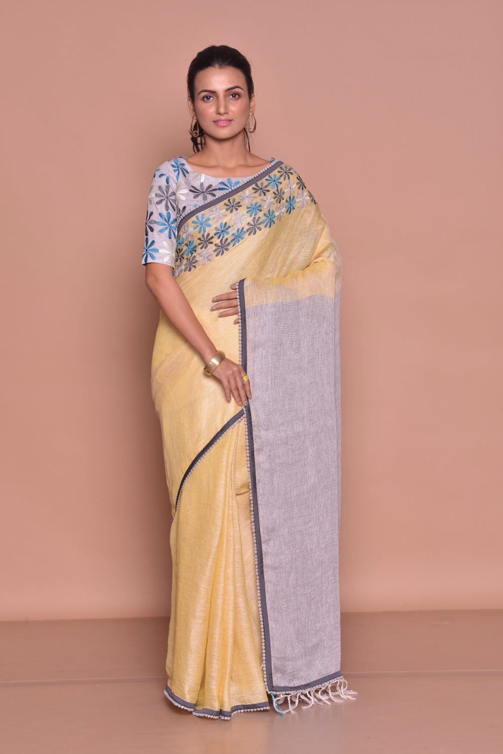 Shop stunning yellow embroidered sari online in USA with lilac pallu and lilac embroidered sari blouse. Be occasion ready with exquisite range of designer sarees with blouse, bridal sarees from Pure Elegance Indian boutique in USA.-full view