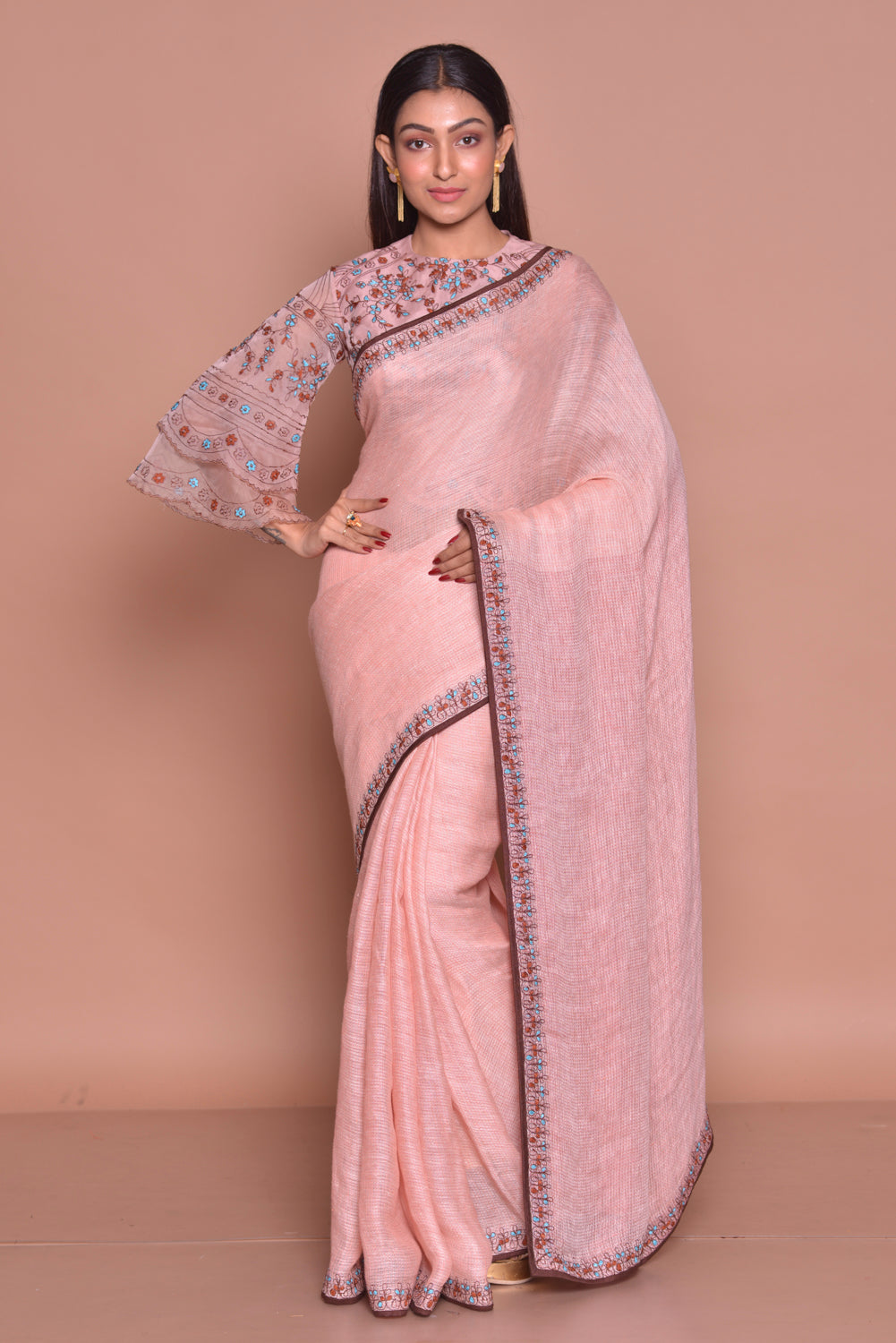 Buy champagne pink embroidered saree online in USA with matching embroidered sari blouse. Be occasion ready with exquisite range of designer sarees with blouse, bridal sarees from Pure Elegance Indian boutique in USA.-full view
