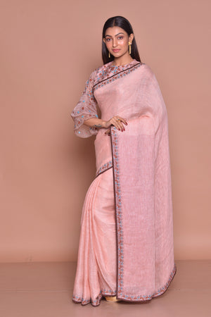 Buy champagne pink embroidered saree online in USA with matching embroidered sari blouse. Be occasion ready with exquisite range of designer sarees with blouse, bridal sarees from Pure Elegance Indian boutique in USA.-side