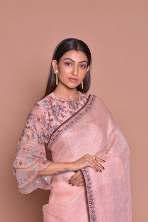 Buy champagne pink embroidered saree online in USA with matching embroidered sari blouse. Be occasion ready with exquisite range of designer sarees with blouse, bridal sarees from Pure Elegance Indian boutique in USA.-closeup