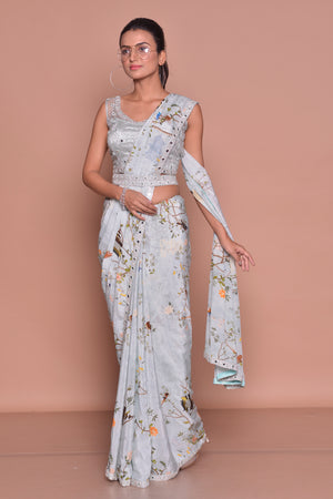 Shop powder blue floral belted saree online in USA with embroidered sleeveless saree blouse. Look fashionable on special occasions in contemporary sarees, designer sarees with blouse, embroidered saris from Pure Elegance Indian luxury clothing store in USA.-side