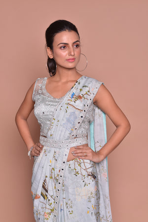 Shop powder blue floral belted saree online in USA with embroidered sleeveless saree blouse. Look fashionable on special occasions in contemporary sarees, designer sarees with blouse, embroidered saris from Pure Elegance Indian luxury clothing store in USA.-closeup
