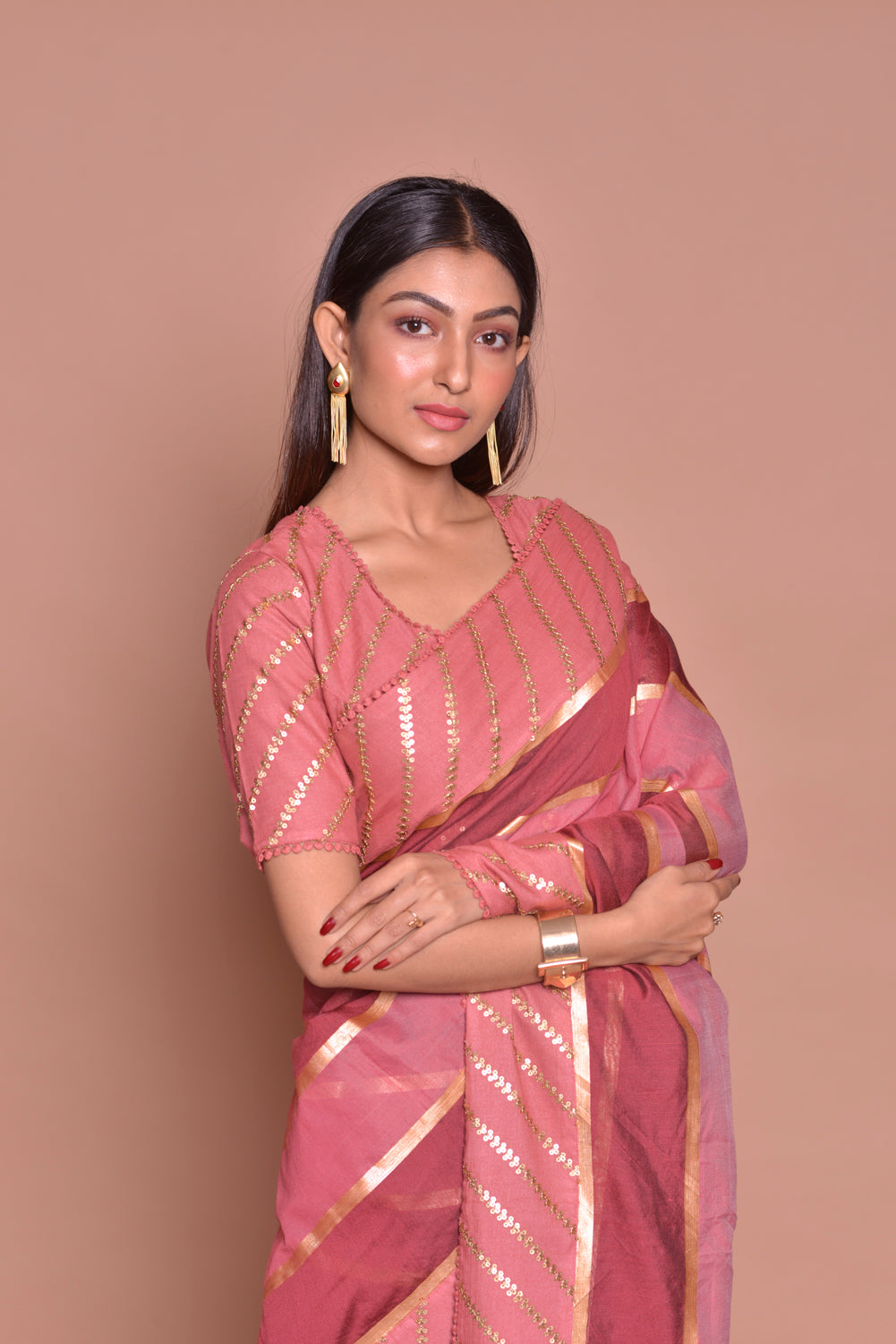 Shop beautiful pink and red embroidered saree online in USA with matching embroidered sari blouse. Be occasion ready with exquisite range of designer sarees with blouse, bridal sarees from Pure Elegance Indian boutique in USA.-closeup