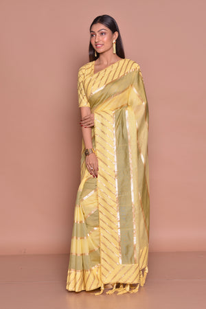 Buy stunning yellow and olive color embroidered sari online in USA with matching embroidered sari blouse. Be occasion ready with exquisite range of designer sarees with blouse, bridal sarees from Pure Elegance Indian boutique in USA.-side