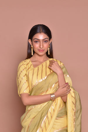 Buy stunning yellow and olive color embroidered sari online in USA with matching embroidered sari blouse. Be occasion ready with exquisite range of designer sarees with blouse, bridal sarees from Pure Elegance Indian boutique in USA.-closeup