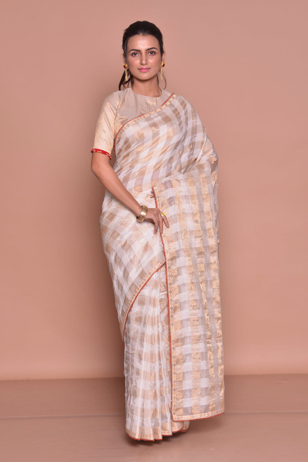 Buy cream and golden check saree online in USA with saree blouse. Be occasion ready with exquisite range of designer sarees with blouse, bridal sarees from Pure Elegance Indian boutique in USA.-full view