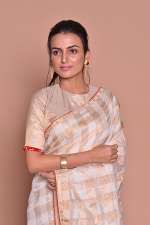 Buy cream and golden check saree online in USA with saree blouse. Be occasion ready with exquisite range of designer sarees with blouse, bridal sarees from Pure Elegance Indian boutique in USA.-closeup
