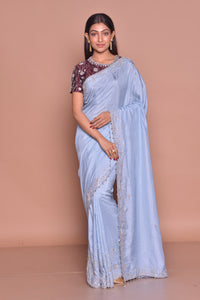Shop stunning light blue embroidered tussar georgette saree online in USA with maroon embroidered saree blouse. Look fashionable on special occasions in contemporary sarees, designer sarees with blouse, embroidered saris from Pure Elegance Indian luxury clothing store in USA.-full view