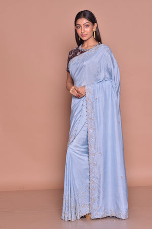 Shop stunning light blue embroidered tussar georgette saree online in USA with maroon embroidered saree blouse. Look fashionable on special occasions in contemporary sarees, designer sarees with blouse, embroidered saris from Pure Elegance Indian luxury clothing store in USA.-side