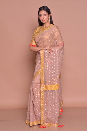 Buy beautiful light brown embroidered sari online in USA with yellow embroidered saree blouse. Be occasion ready with exquisite range of designer sarees with blouse, bridal sarees from Pure Elegance Indian boutique in USA.-side