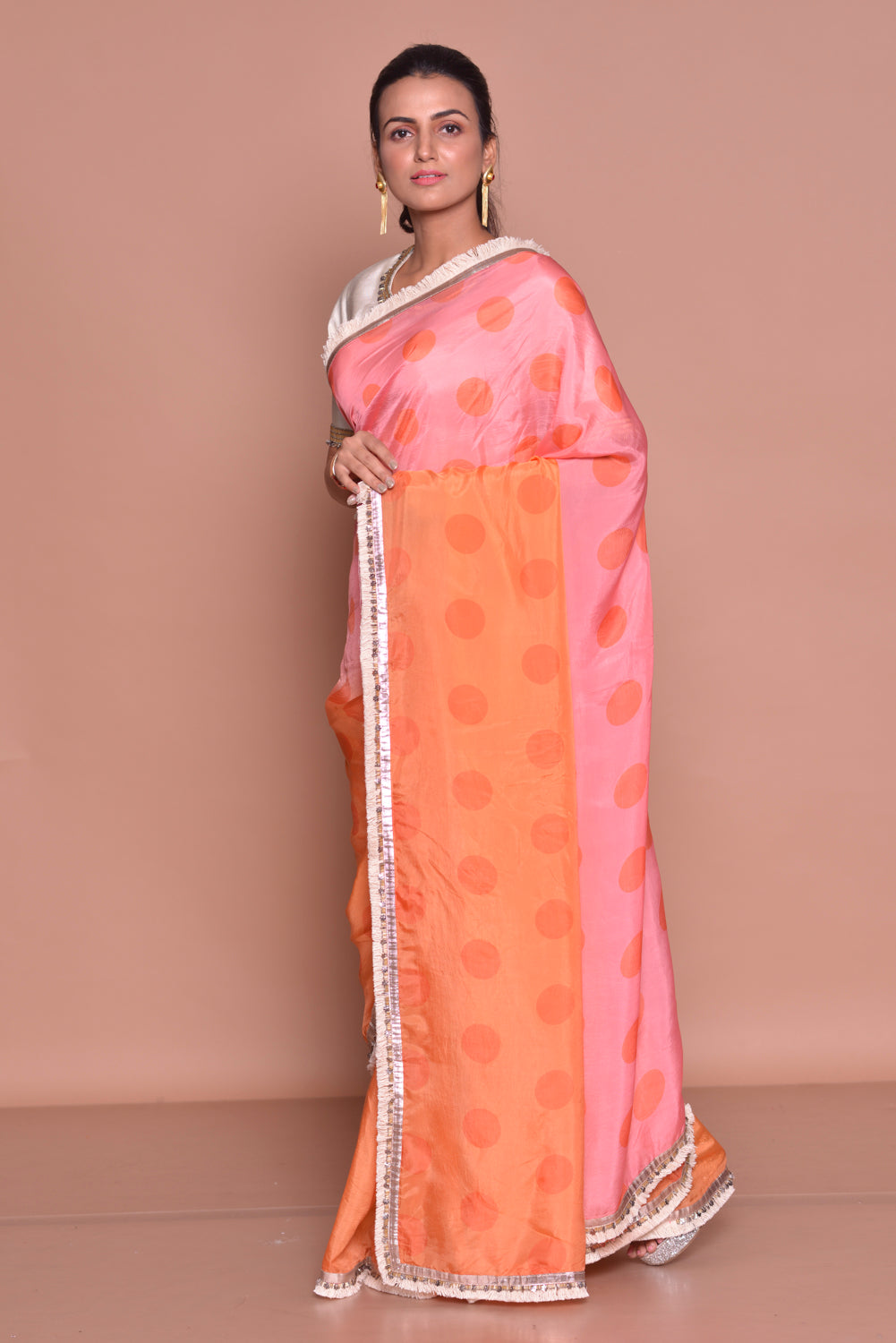 Buy stunning pink and orange polka dot embroidered saree online in USA with embroidered white saree blouse. Be occasion ready with exquisite range of designer sarees with blouse, bridal sarees from Pure Elegance Indian boutique in USA.-side
