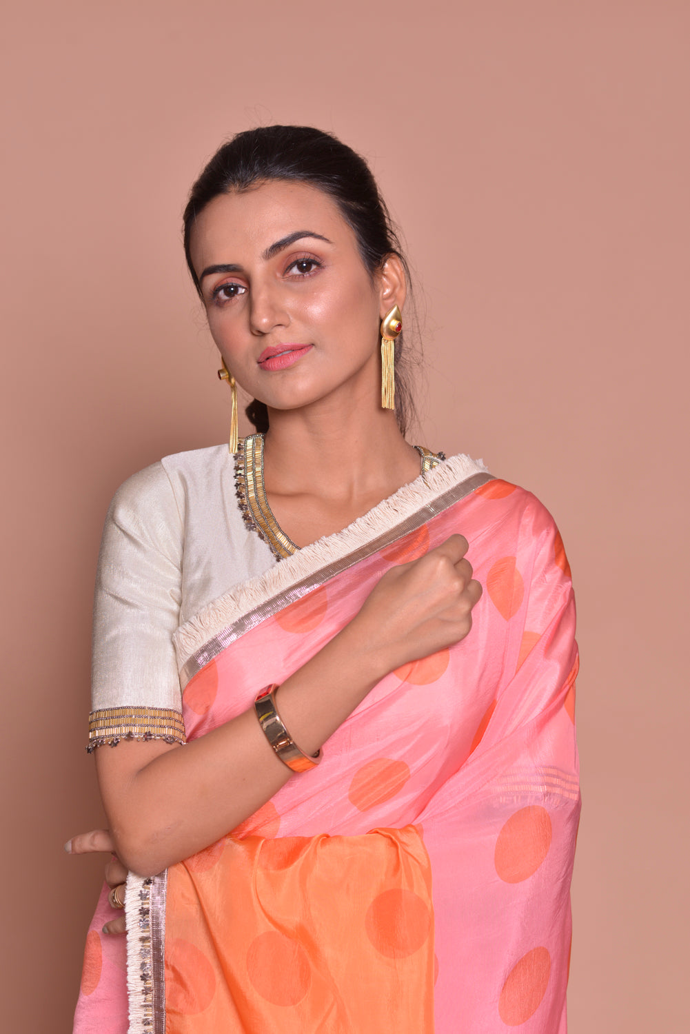 Buy stunning pink and orange polka dot embroidered saree online in USA with embroidered white saree blouse. Be occasion ready with exquisite range of designer sarees with blouse, bridal sarees from Pure Elegance Indian boutique in USA.-closeup