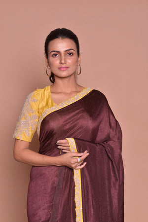 Buy stunning dark brown embroidered sari online in USA with yellow embroidered saree blouse. Be occasion ready with exquisite range of designer sarees with blouse, bridal sarees from Pure Elegance Indian boutique in USA.-closeup