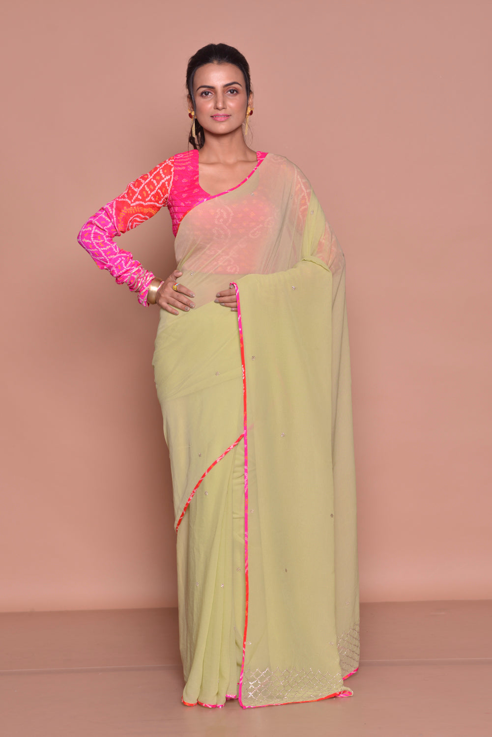 Buy pistachio green embroidered sari online in USA with pink bandhej saree blouse. Be occasion ready with exquisite range of designer sarees with blouse, bridal sarees from Pure Elegance Indian boutique in USA.-full view