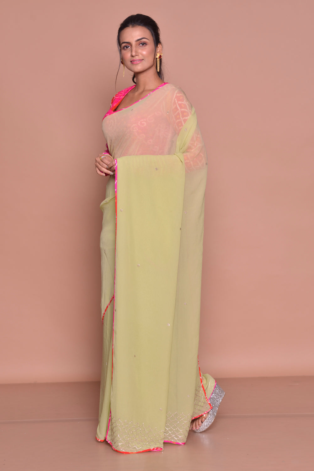Buy pistachio green embroidered sari online in USA with pink bandhej saree blouse. Be occasion ready with exquisite range of designer sarees with blouse, bridal sarees from Pure Elegance Indian boutique in USA.-side