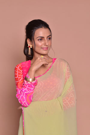 Buy pistachio green embroidered sari online in USA with pink bandhej saree blouse. Be occasion ready with exquisite range of designer sarees with blouse, bridal sarees from Pure Elegance Indian boutique in USA.-closeup