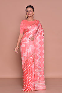 Shop peach embroidered and printed saree online in USA with embroidered sari blouse. Be occasion ready with exquisite range of designer sarees with blouse, bridal sarees from Pure Elegance Indian boutique in USA.-full view