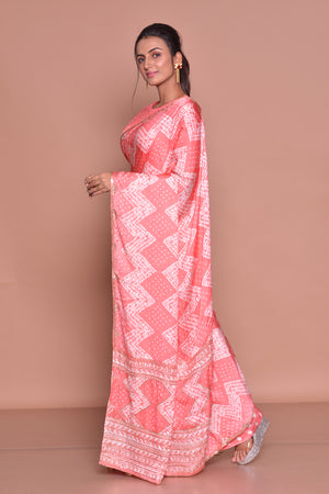 Shop peach embroidered and printed saree online in USA with embroidered sari blouse. Be occasion ready with exquisite range of designer sarees with blouse, bridal sarees from Pure Elegance Indian boutique in USA.-side