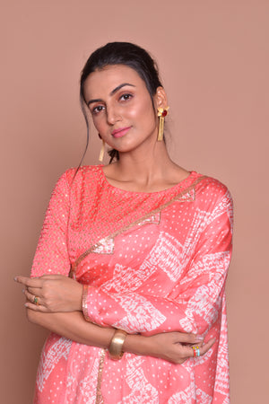 Shop peach embroidered and printed saree online in USA with embroidered sari blouse. Be occasion ready with exquisite range of designer sarees with blouse, bridal sarees from Pure Elegance Indian boutique in USA.-closeup
