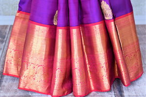 Shop beautiful purple Kanjeevaram saree online in USA with pink zari border and zari buta. Go for rich traditional festive look with beautiful Kanchipuram silk sarees, soft silk sarees, Banarasi silk saris from Pure Elegance Indian cloth store in USA. -pleats