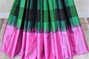 Shop beautiful green check Gadhwal silk saree online in USA with solid pink border. Let your elegance be the highlight of every occasion with stunning handwoven saris, soft silk sarees, traditional Kanchipuram sarees from Pure Elegance Indian fashion boutique in USA.-pleats