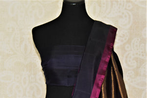 Shop peach Gadhwal silk sari online in USA with solid black border. Let your elegance be the highlight of every occasion with stunning handwoven saris, soft silk sarees, traditional Kanchipuram sarees from Pure Elegance Indian fashion boutique in USA.-blouse pallu