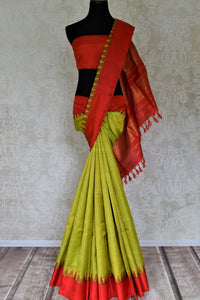 Shop gorgeous pistachio green check Gadhwal silk saree online in USA with solid red border. Let your elegance be the highlight of every occasion with stunning handwoven saris, soft silk sarees, traditional Kanchipuram sarees from Pure Elegance Indian fashion boutique in USA.-full view
