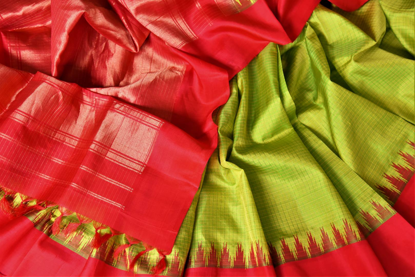 Shop gorgeous pistachio green check Gadhwal silk saree online in USA with solid red border. Let your elegance be the highlight of every occasion with stunning handwoven saris, soft silk sarees, traditional Kanchipuram sarees from Pure Elegance Indian fashion boutique in USA.-details