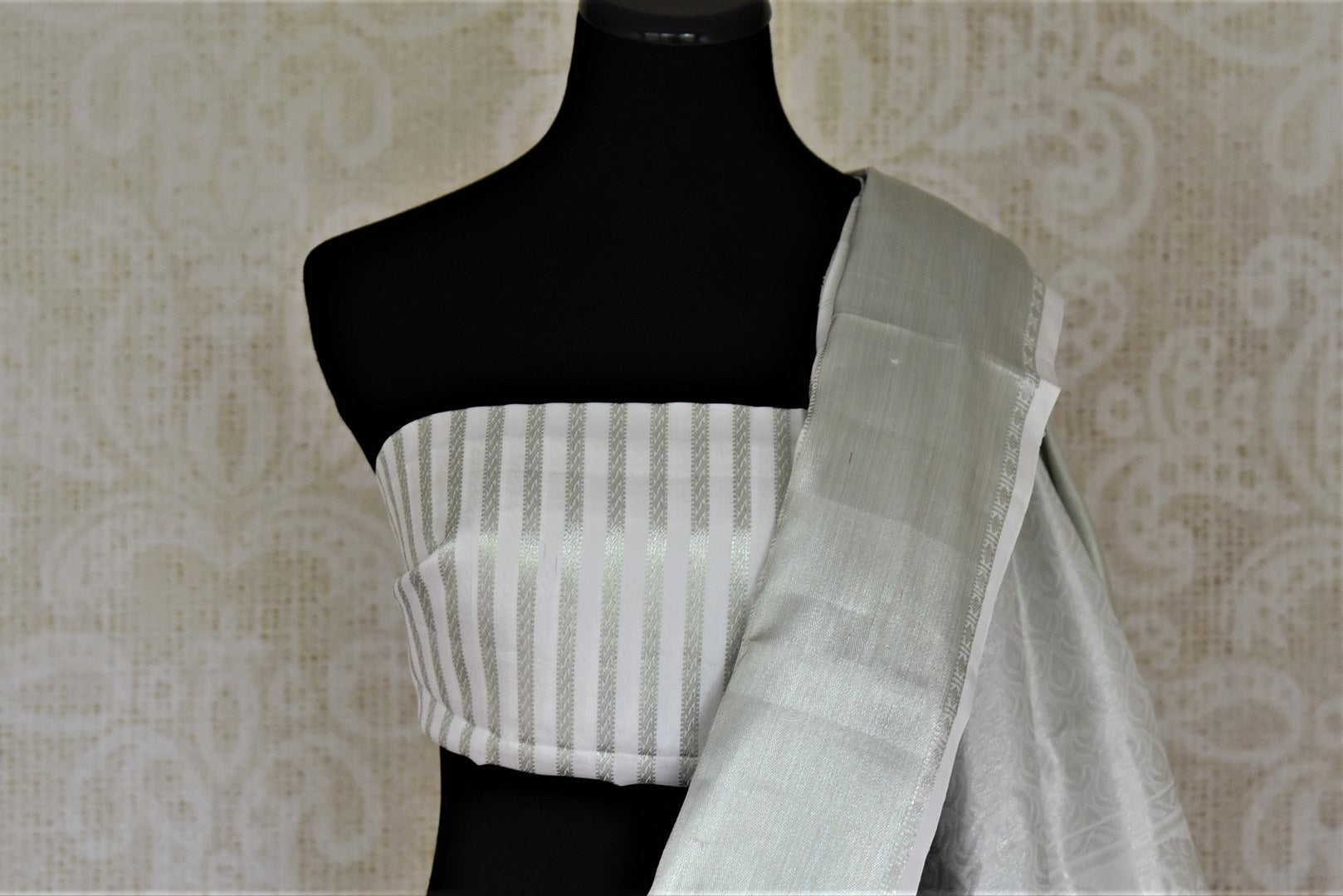 Shop elegant white zari stripes Kanjivaram sari online in USA. Let your elegance be the highlight of every occasion with stunning handwoven sarees, soft silk sarees, traditional Kanchipuram sarees from Pure Elegance Indian fashion boutique in USA.-blouse pallu
