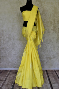 Buy stunning lemon yellow Kanjivaram saree online in USA with big silver zari buta. Go for rich traditional festive look with beautiful Kanchipuram silk sarees, soft silk sarees, Banarasi silk saris from Pure Elegance Indian cloth store in USA. -full view