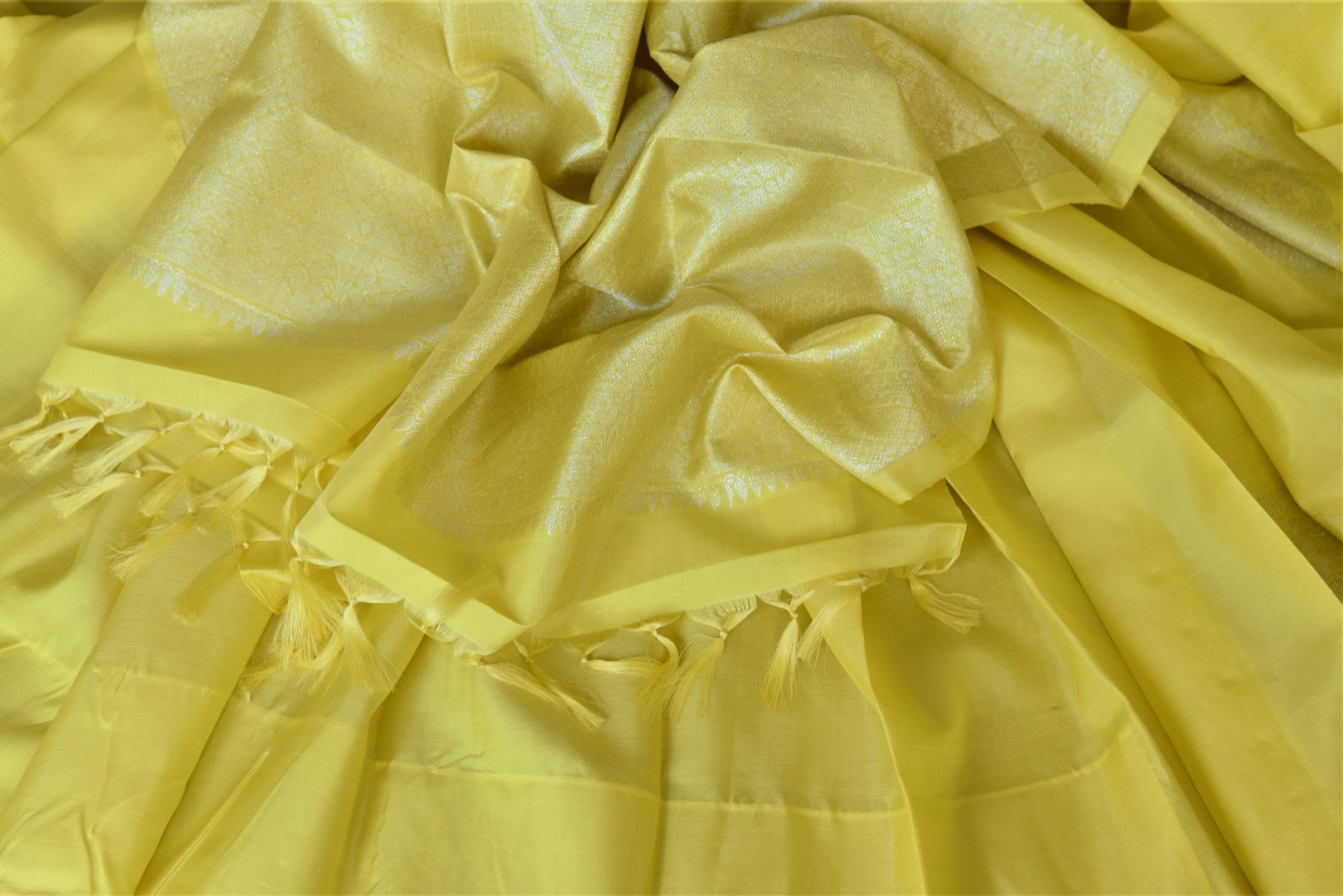 Buy stunning lemon yellow Kanjivaram saree online in USA with big silver zari buta. Go for rich traditional festive look with beautiful Kanchipuram silk sarees, soft silk sarees, Banarasi silk saris from Pure Elegance Indian cloth store in USA. -details