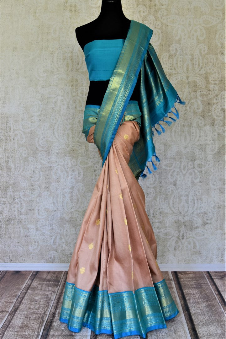 Buy beautiful dusty pink Kanjivaram saree online in USA with blue zari border and zari buta. Go for rich traditional festive look with beautiful Kanchipuram silk sarees, soft silk sarees, Banarasi silk saris from Pure Elegance Indian cloth store in USA. -full view