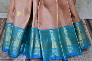 Buy beautiful dusty pink Kanjivaram saree online in USA with blue zari border and zari buta. Go for rich traditional festive look with beautiful Kanchipuram silk sarees, soft silk sarees, Banarasi silk saris from Pure Elegance Indian cloth store in USA. -pleats
